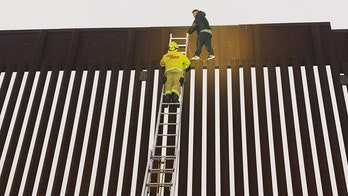 California firefighters rescue man stuck on top of US-Mexico border wall