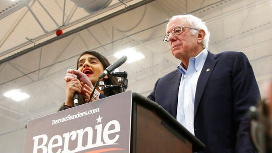Bernie Sanders interrupted by topless protesters at Nevada rally