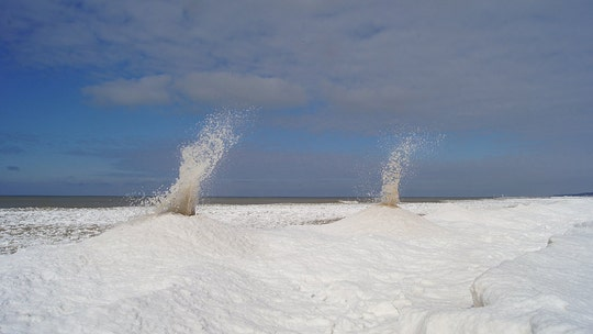 'Ice volcanoes' erupt on Michigan beach during Arctic blast