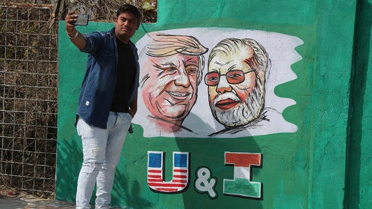 Trump fans in India worship president with statues, prayers as government accused of 'hiding' slums behind walls