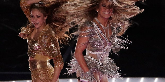 Singers Shakira, left, and Jennifer Lopez perform during the halftime show at the NFL Super Bowl 54.