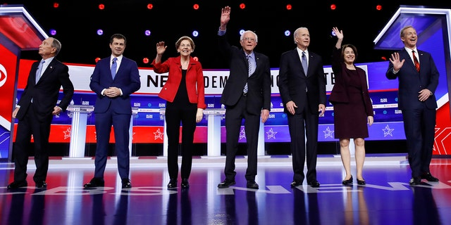 From left, Democratic presidential candidates, former New York City Mayor Mike Bloomberg, former South Bend Mayor Pete Buttigieg, Sen. Elizabeth Warren, D-Mass., Sen. Bernie Sanders, I-Vt., former Vice President Joe Biden, Sen. Amy Klobuchar, D-Minn., and businessman Tom Steyer participate in a Democratic presidential primary debate, Tuesday, Feb. 25, 2020, in Charleston, S.C. (AP Photo/Matt Rourke)