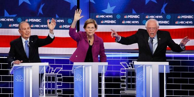 Former New York City Mayor Mike Bloomberg, Sen. Elizabeth Warren, D-Mass., and Sen. Bernie Sanders, I-Vt., during last week's Nevada debate. (AP Photo/John Locher)