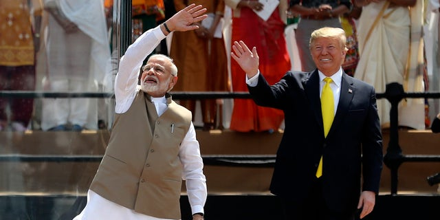 U.S. President Donald Trump and Indian Prime Minister Narendra Modi wave to the crowd at Sardar Patel Stadium in Ahmedabad, India, Monday, Feb. 24, 2020. (AP Photo/Aijaz Rahi)