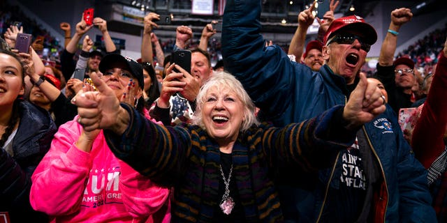 Supporters of President Donald Trump cheering as he arrived to speak at the rally. (AP Photo/Evan Vucci)