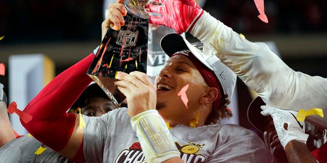 Kansas City Chiefs' Patrick Mahomes hoists the trophy after defeating the San Francisco 49ers at Super Bowl LIV. (AP Photo/David J. Phillip)