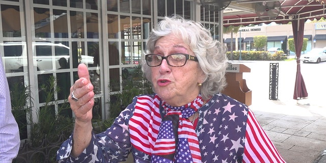 Eighty-five-year-old Maria Falcon says she came to Miami 40 years ago. Wearing a red, white and blue star spangled U.S.A themed outfit, she held nothing back, speaking in both English and Spanish.