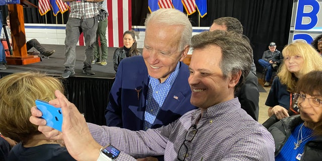 Former Vice President Joe Biden takes selfies with supporters at a post-Nevada caucus celebration, in North Las Vegas, Nevada on Feb. 22. 2020