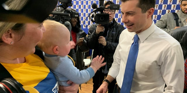 Democratic presidential candidate Pete Buttigieg thanks staff and volunteers during a stop at a campaign field office in West Des Moines, IA on Feb. 3, 2020