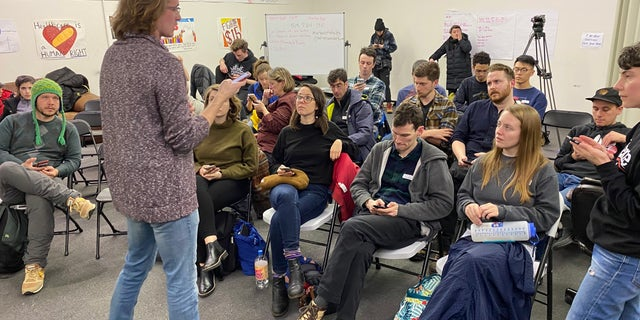 Bernie Sanders volunteers learn how to canvass and phone bank at a training session at a Sanders campaign field office in Des Moines, Iowa on Jan. 31, 2020