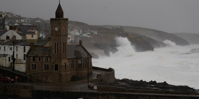 Powerful waves break on the shoreline around the small port of Porthleven, south west England, Sunday, Feb. 16, 2020.