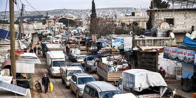Civilians flee from Idlib toward the north to find safety inside Syria near the border with Turkey, Saturday, Feb. 15, 2020. (AP Photo)