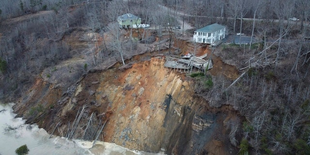 This drone photo provided by Hardin County Fire Department, Savannah, Tenn. on Feb. 15, 2030, shows the landslide on Chalk bluff on the Tennessee River. Authorities say two homes were destroyed when a hillside collapsed near a swollen river in western Tennessee.(Melvin Martin /Hardin County Fire Department, Savannah, Tenn. via AP)