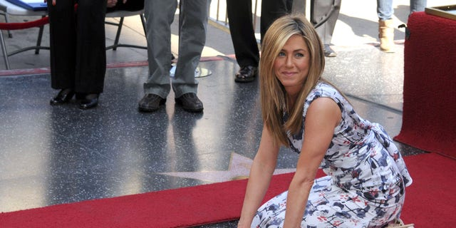 Westlake Legal Group 7b4f1c7c-GettyImages-139568686 Jennifer Aniston turns 51: A look back at her biggest moments Nate Day fox-news/topic/celebrity-birthdays fox-news/person/jennifer-aniston fox-news/person/brad-pitt fox-news/entertainment/tv fox-news/entertainment/movies fox-news/entertainment/friends fox-news/entertainment/events/couples fox-news/entertainment/celebrity-news fox-news/entertainment fox news fnc/entertainment fnc article 3a8b507d-4d4a-5f3f-a845-ed0466492132