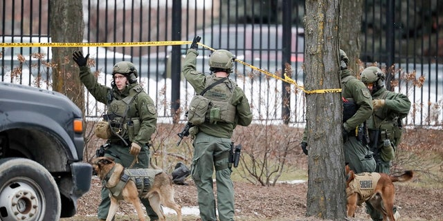 Police respond to reports of an active shooting at the Molson Coors Brewing Co. campus in Milwaukee on Wednesday. (AP Photo/Morry Gash)