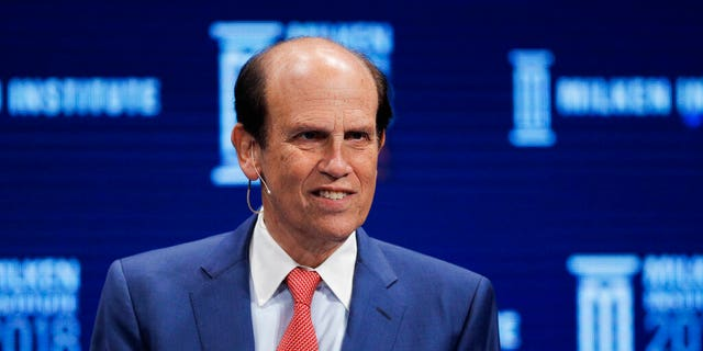 Financier Michael Milken leading a discussion at the Milken Institute Global Conference in Beverly Hills, Calif., in April 2018. (AP Photo/Jae C. Hong, File)