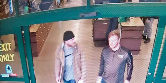 FILE: Surveillance video released by the U.S. Attorney's office in Maryland, Brian Mark Lemley Jr, right, and Patrik Mathews leave a store in Delaware where they purchased ammunition and paper shooting targets.
