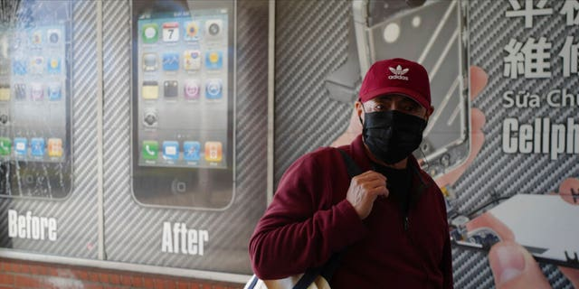 A man wears a protective mask while shopping in Alhambra, Calif., Friday, Jan. 31, 2020.