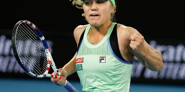 Sofia Kenin of the U.S. reacts after winning a point against Spain's Garbine Muguruza during the women's final at the Australian Open tennis championship in Melbourne, Australia, Saturday, Feb. 1, 2020. (AP Photo/Dita Alangkara)