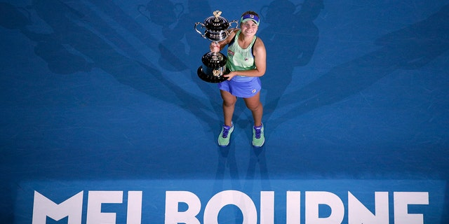 Sofia Kenin of the U.S. holds the Daphne Akhurst Memorial Cup after defeating Spain's Garbine Muguruza in the women's singles final at the Australian Open tennis championship in Melbourne, Australia, Saturday, Feb. 1, 2020. (AP Photo/Andy Wong)