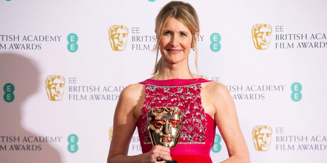 Laura Dern, winner of best supporting actress for 'Marriage Story,' poses with her award backstage at the Bafta Film Awards, in central London on Sunday, Feb. 2, 2020.