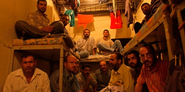 FILE - This Aug. 3, 2005 file photo, Lebanese ex-inmates of the notorious Khiam prison sit in their former cells where they displayed their belongings during a sit-in at the Khiam prison, in southern Lebanon.(AP Photo/Mohammad Zaatari, File)