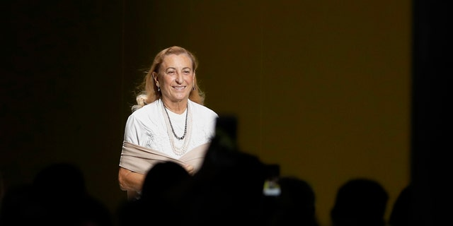 In this Sept. 20, 2018 file photo, Italian designer Miuccia Prada smiles after presenting her women's 2019 Spring-Summer collection, unveiled during the Fashion Week in Milan, Italy.聽