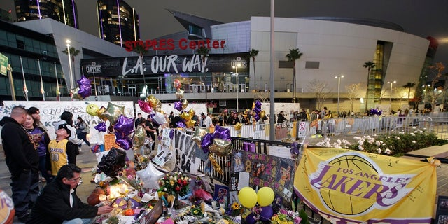 Fans gathered at a memorial for Kobe Bryant in front of Staples Center in Los Angeles following his death. (AP Photo/Damian Dovarganes, File)