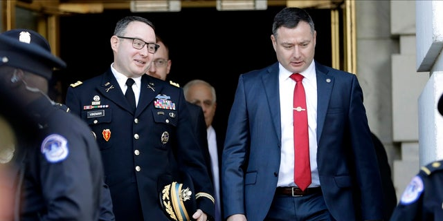 Lt. Col. Alexander Vindman, left, walks with his twin brother, Army Lt. Col. Yevgeny Vindman, in November 2019 after testifying before the House Intelligence Committee. (AP Photo/Julio Cortez, File)