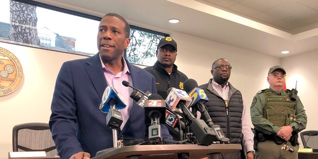 Forrest City, Ark., Mayor Cedric Williams, left, holding a news conference after two police officers were wounded and a gunman was killed in an exchange of gunfire at a Walmart in eastern Arkansas on Monday morning. (AP Photo/Adrian Sainz)
