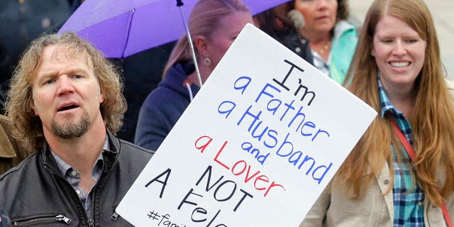 "FILE: Kody Brown, left, from TV's reality show ""Sister Wives,"" marches during a protest at the state Capitol, in Salt Lake City."