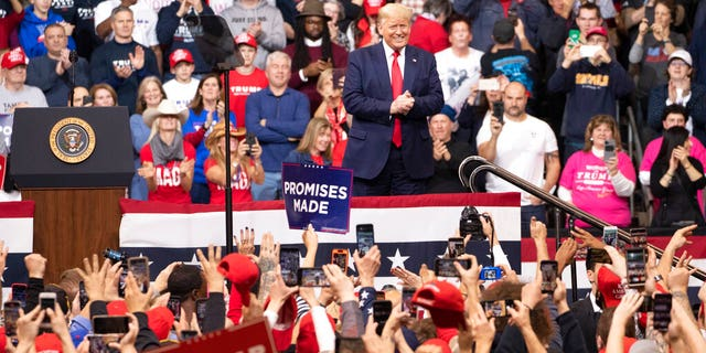 The audience cheers as President Donald Trump arrives on stage during a campaign rally, Monday, Feb. 10, 2020, in Manchester, N.H. (AP Photo/Mary Altaffer)