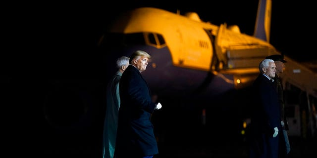 President Donald Trump and Vice President Mike Pence depart after watching a casualty return for Sgt. 1st Class Javier Gutierrez, of San Antonio, Texas and Sgt. 1st Class Antonio Rodriguez, of Las Cruces, N.M., Monday, Feb. 10, 2020, at Dover Air Force Base, Del. According to the Department of Defense both died Saturday, Feb. 8, during combat operations in Afghanistan. (AP Photo/Evan Vucci)