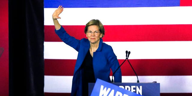Democratic presidential candidate Sen. Elizabeth Warren, D-Mass., waves to supporters as she leaves the stage after a primary election night rally, Tuesday, Feb. 11, 2020, in Nashua, N.H. (AP Photo/Bill Sikes)