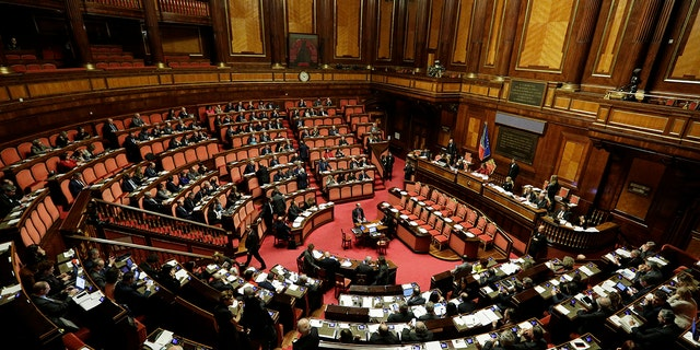 A view of the Italian Senate during the debate on whether to allow opposition populist leader Matteo Salvini to be prosecuted – as he demands to be -- for alleging holding migrants hostage for days aboard a coast guard ship instead of letting them immediately disembark in Sicily while he was interior minister. (AP Photo/Andrew Medichini)