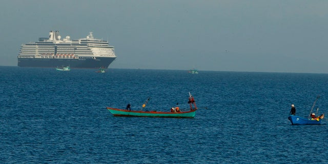 The MS Westerdam sails off Sihanoukville, Cambodia on Thursday. Holland America Line said the ship has been turned away by the Philippines, Taiwan, Japan and Thailand, though its operator said no cases of the disease have been confirmed among the more than 2,200 passengers and crew. (AP Photo/Heng Sinith)