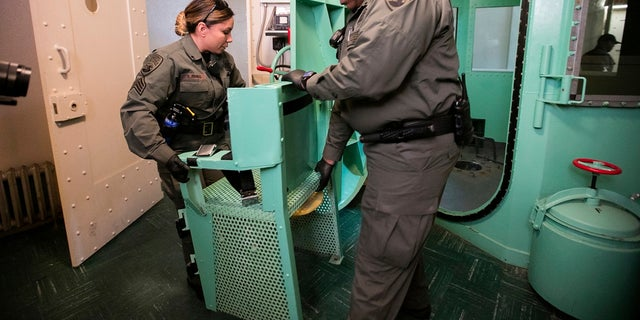 In this March 13, 2019, file photo provided by the California Department of Corrections and Rehabilitation a chair is removed from the death penalty chamber at San Quentin State Prison in San Quentin, Calif. (California Department of Corrections and Rehabilitation via AP, File)