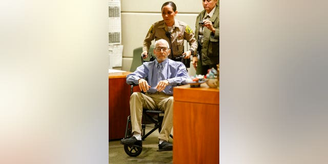 In this Jan. 6, 2017 file photo real estate heir Robert Durst is wheeled into a courtroom in a Los Angeles Superior Court Airport Branch in Los Angeles. Durst faces trial in the slaying of his best friend 20 years ago. Jury selection begins Wednesday, Jan.19, 2020, in Los Angeles. (Mark Boster/Los Angeles Times via AP, Pool,File)