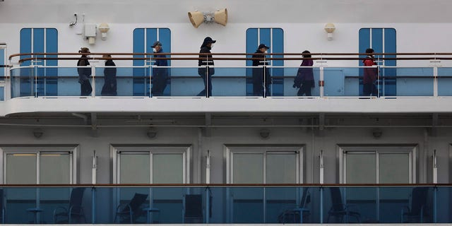 A group of quarantined passengers exercise on the Diamond Princess cruise ship Saturday, Feb. 15, 2020, in Yokohama, near Tokyo. (Associated Press)
