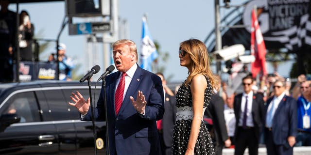 """President Trump, accompanied by first lady Melania Trump, giving the instructions """"gentlemen, start your engines,"""" before the start of the Daytona 500."""
