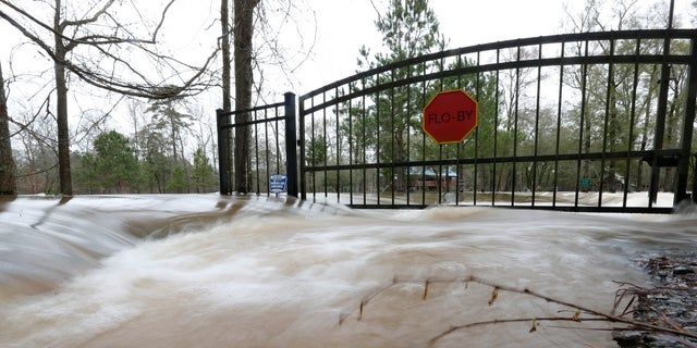 This time exposure shows the strength of the Pearl River floodwaters on this residence on Florence-Byram Road near Byram, Miss., on Monday, Feb. 17, 2020. (AP Photo/Rogelio V. Solis)