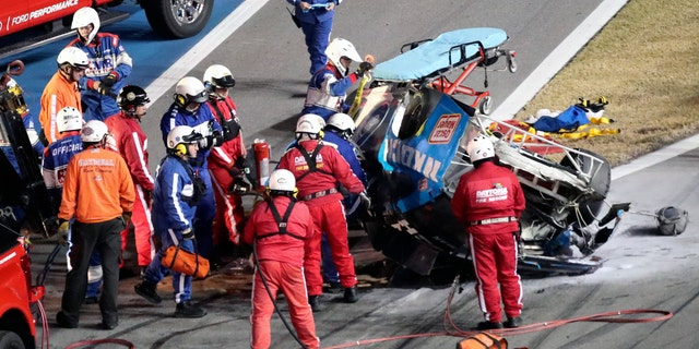 Rescue workers arriving to check on Ryan Newman after he was involved in a wreck on the last lap of the Daytona 500. (AP Photo/David Graham)