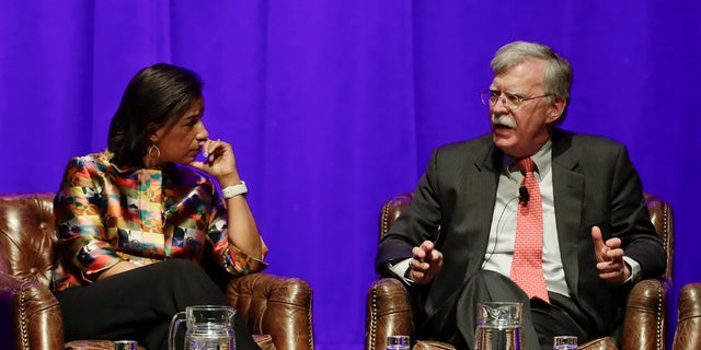 Former national security advisers Susan Rice, left, and John Bolton take part in a discussion on global leadership at Vanderbilt University, Wednesday in Nashville, Tenn. (AP Photo/Mark Humphrey)