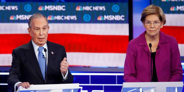 Democratic presidential candidates, former New York City Mayor Mike Bloomberg, left, speaks as Sen. Elizabeth Warren, D-Mass., looks on during a Democratic presidential primary debate Wednesday, Feb. 19, 2020, in Las Vegas, hosted by NBC News and MSNBC. (AP Photo/John Locher)