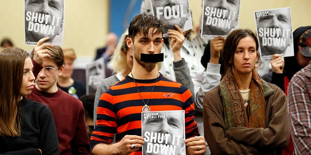 Jan. 8, 2019: Protesters hold signs as they turn their backs on a meeting of the Virginia State Air Quality Control Board in Richmond, Va. The U.S. Supreme Court is set to wade into a long-running battle between developers of a 605-mile natural gas pipeline and environmental groups who oppose the pipeline crossing the storied Appalachian Trail. On Monday, Feb. 24, 2020, the high court will hear arguments on a critical permit needed by developers of the Atlantic Coast Pipeline. (AP Photo/Steve Helber, File)