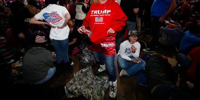 Jody Miller of Scottsdale, Ariz., waiting for an appearance by President Trump at the rally Thursday in Colorado Springs. (AP Photo/David Zalubowski)