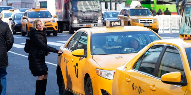 A passenger gets into a taxi in New York.