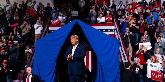 President Trump taking the stage in Colorado Springs, Colo. (AP Photo/Evan Vucci)