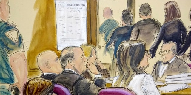 In this courtroom drawing, Harvey Weinstein, center, sits at the defense table surrounded by his attorneys as jurors file out of the courtroom after being told by the judge to go back and keep deliberating in Weinstein's rape case, Friday, Feb. 21, 2020, at Manhattan Supreme Court in New York.