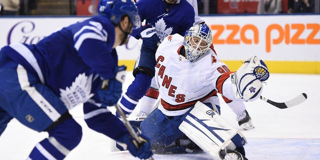 Toronto Maple Leafs left wing Pierre Engvall (47) scores his team's third goal of the game against Carolina Hurricanes emergency goalie David Ayres (90) during second-period NHL hockey game action in Toronto, Saturday, Feb. 22, 2020. (Associated Press)